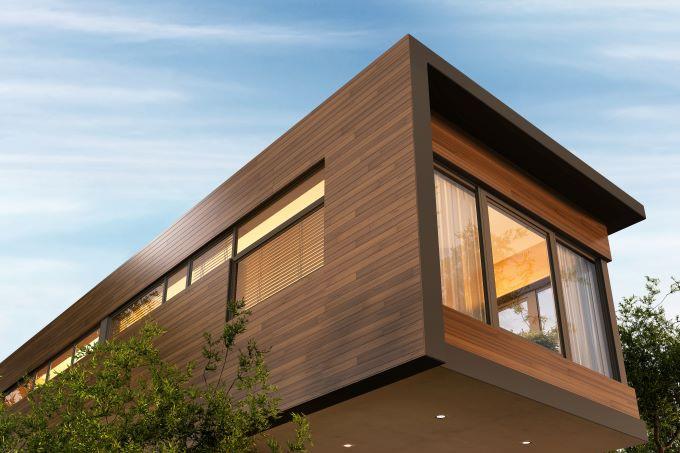 fatada casa moderna lemn structura suspendata lumini aprinse etaj
