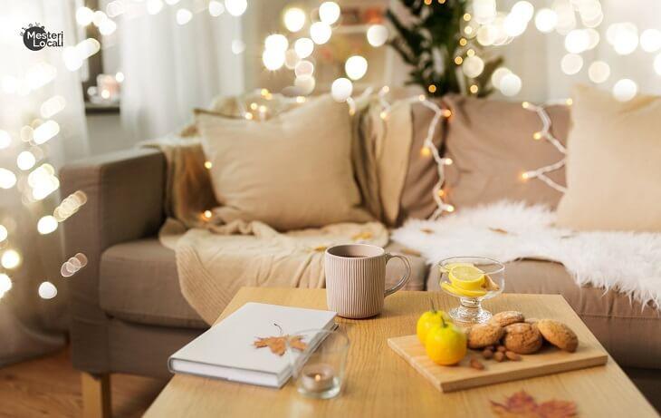 canapea hygge cana ceai lumina ambientala masa living